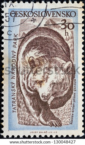 """CZECHOSLOVAKIA - CIRCA 1957: A stamp printed in Czechoslovakia from the """"Tatra National Park"""" issue shows a Brown bear (Ursus arctos), circa 1957. - stock photo"""