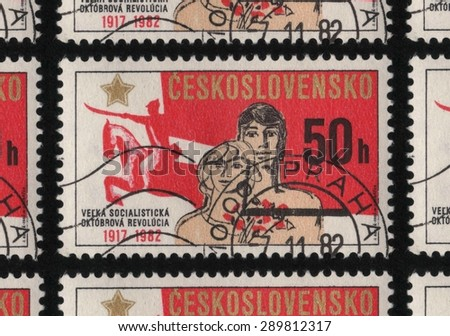 CZECHOSLOVAKIA â?? CIRCA 1982: A stamp printed in Czechoslovakia from â??The 65th Anniversary of October Revolution and 60th Anniversary of U.S.S.Râ? issue, shows a mounted horse and people with flowers.  - stock photo