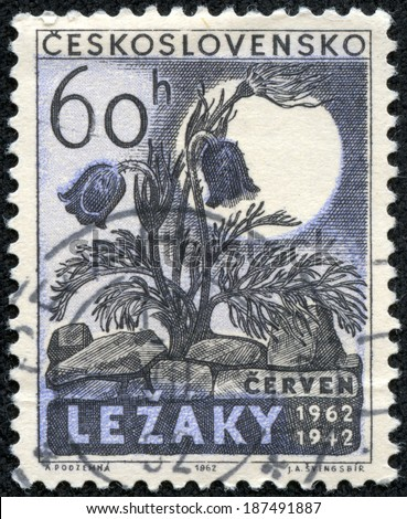CZECHOSLOVAKIA - CIRCA 1962: A stamp printed in Czechoslovakia honoring 20th Anniversary of Destruction of Lidice and Lezaky, shows Flowers and Lezaky ruins, circa 1962 - stock photo