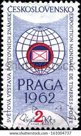 "CZECHOSLOVAKIA - CIRCA 1961: A stamp printed in Czechoslovakia issued for the ""PRAGA 1962"" International Stamp Exhibition shows Exhibition Emblem, circa 1961.  - stock photo"