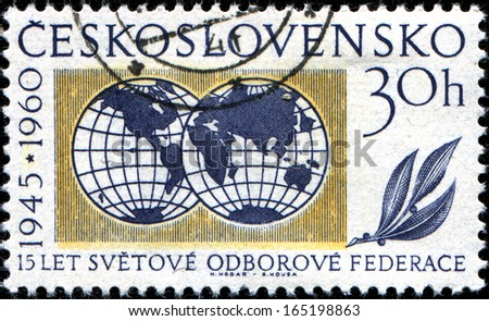 CZECHOSLOVAKIA - CIRCA 1960: A stamp printed in Czechoslovakia issued for the 15th anniversary of W.F.T.U shows two globes, circa 1960 - stock photo