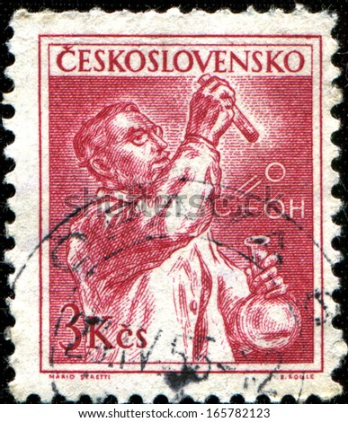 CZECHOSLOVAKIA - CIRCA 1954: A stamp printed in Czechoslovakia shows a chemist, circa 1954 - stock photo