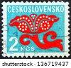 CZECHOSLOVAKIA - CIRCA 1972: A stamp printed in Czechoslovakia shows a stylized plant, circa 1972. - stock photo