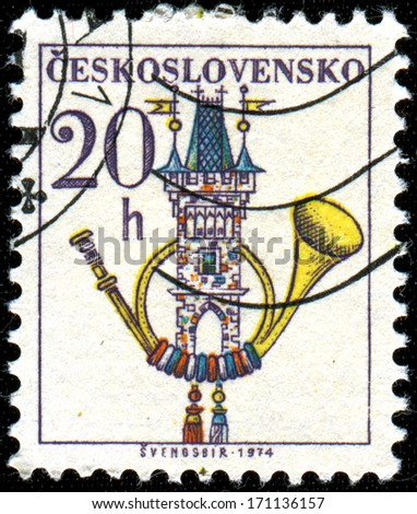 CZECHOSLOVAKIA - CIRCA 1974: A stamp printed in  Czechoslovakia shows  Post Horn and  Old Town Bridge Tower - stock photo