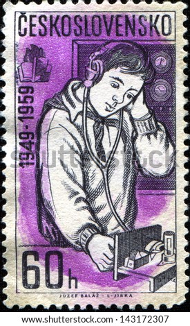 CZECHOSLOVAKIA - CIRCA 1959: A stamp printed in Czechoslovakia shows Young radio technician, 10th Anniv of Young Pioneers' Movement series , circa 1959 - stock photo