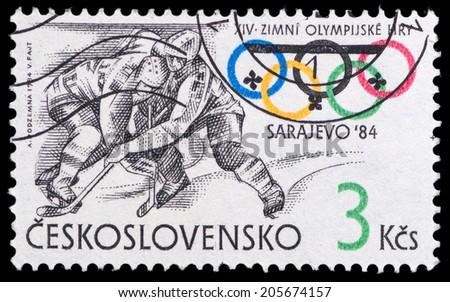 CZECHOSLOVAKIA - CIRCA 1984: A stamp printed in the CZECHOSLOVAKIA, shows hockey, series Olympic Games Sarajevo 1984, circa 1984 - stock photo