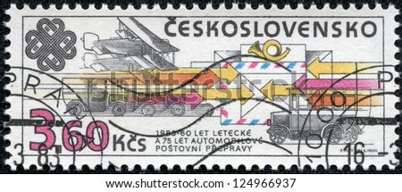 CZECHOSLOVAKIA - CIRCA 1983: A stamp printed in the Czechoslovakia, shows the different types of mail delivery: airmail, road transport, railway transport, circa 1983 - stock photo