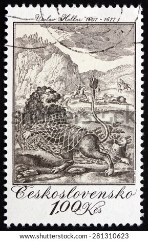 CZECHOSLOVAKIA - CIRCA 1975: a stamp printed in the Czechoslovakia shows The Lion and the Mouse, Engraving by Vaclav Hollar, Hunting Scene, circa 1975 - stock photo