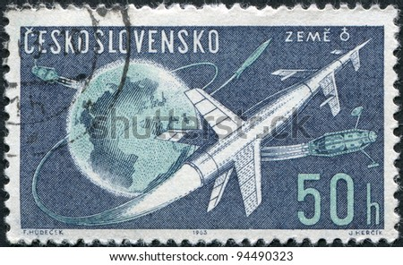 CZECHOSLOVAKIA - CIRCA 1963: A stamp printed in the Czechoslovakia, shows the space rocket flight around the Earth, circa 1963 - stock photo