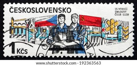 CZECHOSLOVAKIA - CIRCA 1985: a stamp printed in the Czechoslovakia shows Workers, Czech-Soviet Treaty, 1970, circa 1985 - stock photo