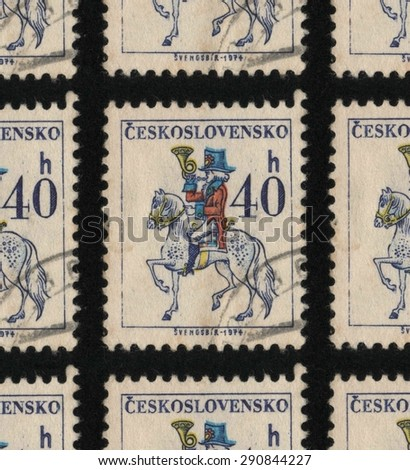 "CZECHOSLOVAKIA - CIRCA 1974 - 1979: A used postage stamp printed in Czechoslovakia from the ""Czechoslovak Postal Services"" issue, showing a postal worker on a white horse.  - stock photo"