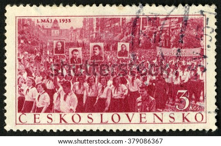 CZECHOSLOVAKIA - CIRCA 1953: post stamp printed in Ceskoslovensko shows crowd of people in may day parade; labor day May 1, 1953; Scott 591 A238 3k red, circa 1953 - stock photo