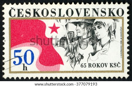 CZECHOSLOVAKIA - CIRCA 1986: post stamp printed in Ceskoslovensko shows star, man, woman and doves; national communist party; 65th anniversary of KSC; Scott 2600 A927 50h, circa 1986 - stock photo