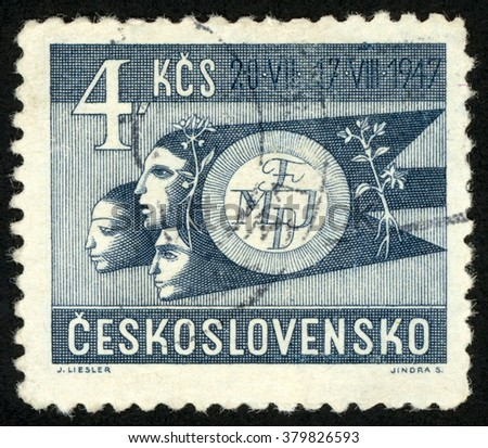 CZECHOSLOVAKIA - CIRCA 1947: post stamp printed in Ceskoslovensko shows three human heads; world federation of youth symbol; (July 20 â?? August 17) Prague; Scott 333 A121 4k blue, circa 1947 - stock photo