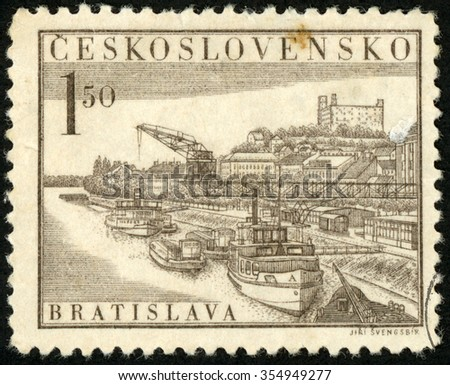CZECHOSLOVAKIA - CIRCA 1952: post stamp printed in Czech (Ceskoslovensko) shows boats on Danube river, Bratislava castle, national philatelic exhibition; Scott 557 A220 1.50k brown; circa 1952 - stock photo