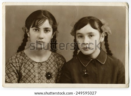 CZECHOSLOVAKIA - CIRCA 1950s: An antique Black & White photo show Two young girlfriends - stock photo