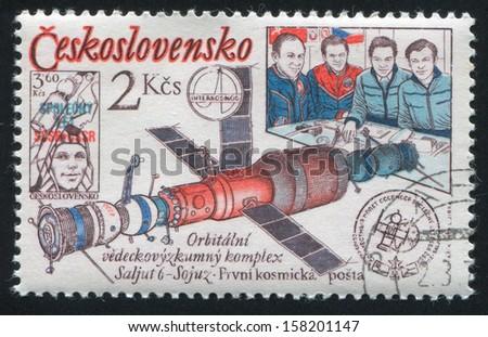 CZECHOSLOVAKIA - CIRCA 1979: stamp printed by Czechoslovakia, shows Salyut-Soyuz orbital complex, post office in space and Czechoslovakia, circa 1979 - stock photo