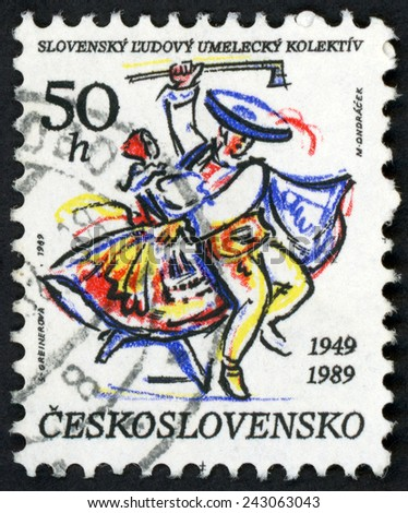 CZECHOSLOVAKIA - CIRCA 1989: stamp printed in Ceskoslovensko (Czech) shows dancing couple, man holding ax; Slovak folk art collective; 40th anniversary; Scott 2752 A991 50h; circa 1989 - stock photo