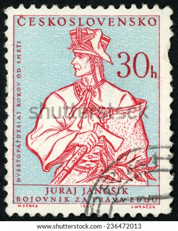 CZECHOSLOVAKIA - CIRCA 1963: stamp printed in Ceskoslovensko shows fighter for human rights Juraj Janosik holdind axe; various cultural personalities & events; Scott 1160 A443 30h red blue; circa 1963 - stock photo