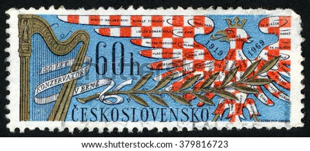 CZECHOSLOVAKIA - CIRCA 1969: stamp printed in Ceskoslovensko shows harp, laurel & musicians names on eagle (1919-1969); 50 years Brno conservatory of music; Scott 1612 A600 60h red blue, circa 1969 - stock photo