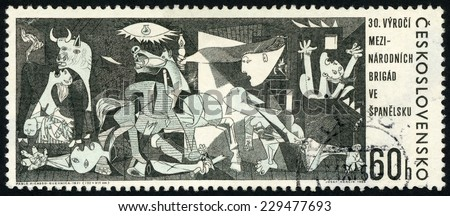 CZECHOSLOVAKIA - CIRCA 1966: stamp printed in Czech (Ceskoslovensko) show painting Guernica 1937 by Pablo Picasso; 30th anniv. of intern. brigade in Spanish civil war; Scott 1408 60h black; circa 1966 - stock photo