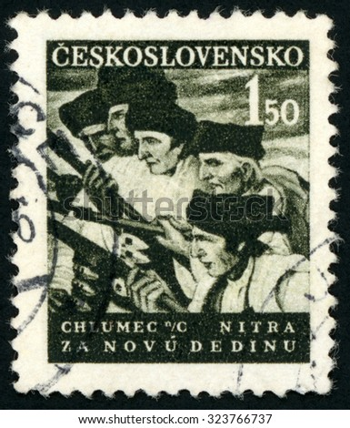 CZECHOSLOVAKIA - CIRCA 1948: stamp printed in Czech (Ceskoslovensko) shows peasants in revolt; 5 men with rifles; abolition of serfdom; Chlumec Nitra; za novu dedinu; Scott 350 A129 1.50k; circa 1948 - stock photo