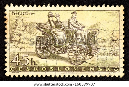 CZECHOSLOVAKIA - CIRCA 1957: Stamps printed in Czechoslovakia with image of an vintage automobile named Prasident to commemorate its 50yrs Anniversary, circa 1957.  - stock photo