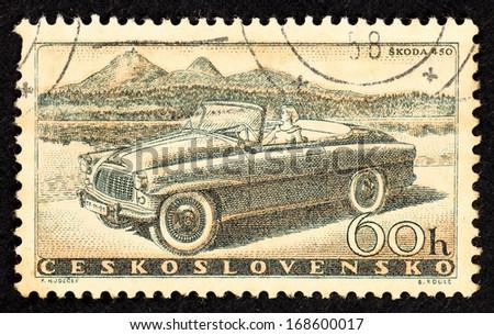 CZECHOSLOVAKIA - CIRCA 1958: Stamps printed in Czechoslovakia with image of the motor-vehicle Skoda 450, circa 1958.  - stock photo