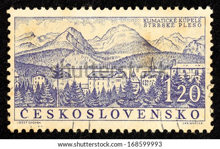CZECHOSLOVAKIA - CIRCA 1958: Stamps printed in Czechoslovakia with landscape image of the spa town Strbske Pleso, circa 1958.  - stock photo
