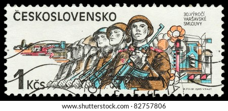 CZECHOSLOVAKIA - CIRCA 1985: The stamp printed in Czechoslovakia shows the armed soldiers, circa 1985 - stock photo