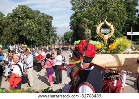 CZESTOCHOWA, POLAND - AUG 11 : Cracow pilgrims dressed in traditional costumes carry the Pope John Paul's II relic (blood) to the Jasna Gora Sanctuary on august 11, 2011 in Czestochowa, Poland - stock photo