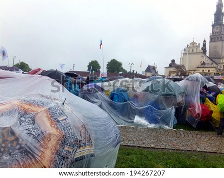 CZESTOCHOWA, POLAND - May 17, 2014: XIX nationwide vigil Renewal in the Holy Spirit before the Jasna Gora peak, in pouring rain, thousands of people of Jasna Gora in Czestochowa, Poland, May 17, 2014  - stock photo