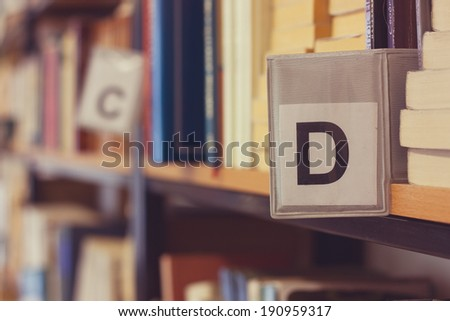 D bookmark on library shelf - stock photo