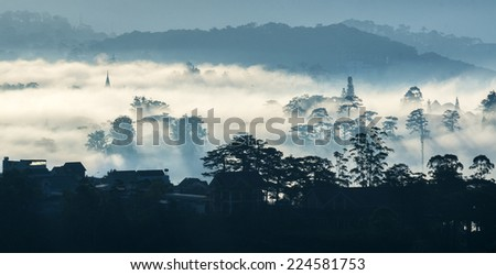 Da Lat city in the fog, mysterious, Vietnam. Da lat is one of the best tourism city in Vietnam. Dalat city is Vietnam's largest vegetable and flowers growing areas. - stock photo