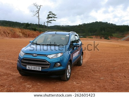 Da Lat, Viet Nam - July 19, 2014: Ford All new EcoSport car running on the mud road in Vietnam - stock photo