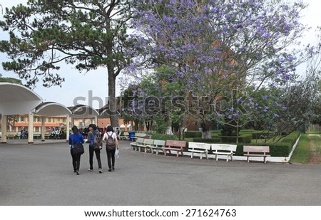 Da Lat, Vietnam - Apr 18, 2015: Vietnamese students walking to classroom in Da Lat Educational College. This old college was built by French under the time they ruled Vietnam. - stock photo