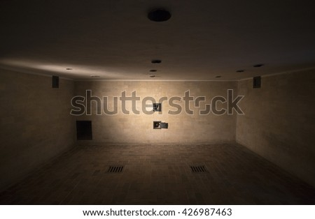DACHAU, GERMANY - DECEMBER 21: The inside of a gas chamber at Dachau Concentration Camp on December 21, 2015 in Dachau, Germany. Tens of thousands of people were killed at Dachau during the Holocaust. - stock photo