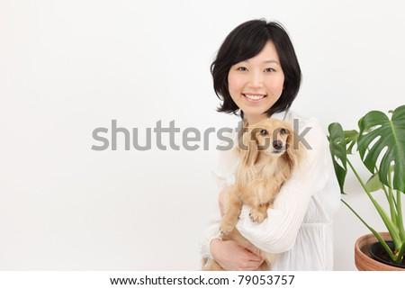 Dachshund and Asian women - stock photo