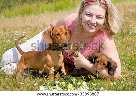 dachshund dogs and girl - stock photo
