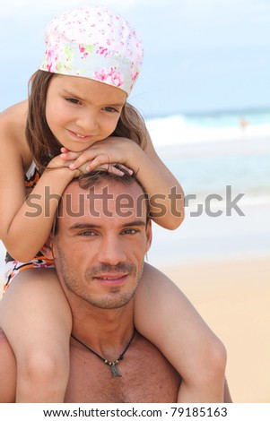 dad and daughter at beach - stock photo