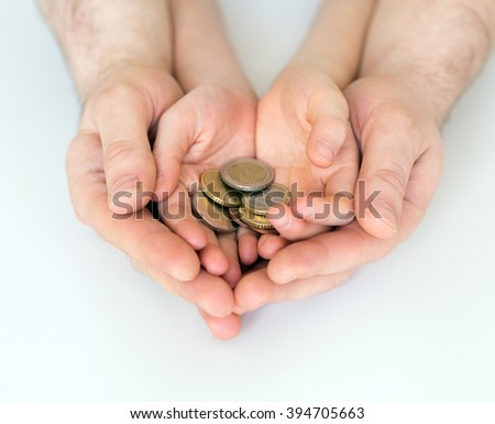 Dad and his daughter holding euro coins. - stock photo