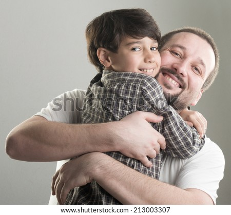 Dad and little son hugging - stock photo