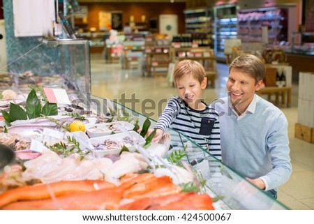 Dad and son at showcase - stock photo