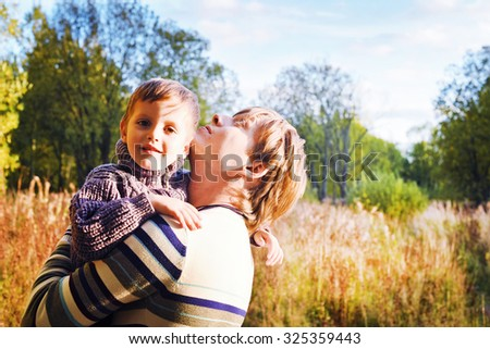 dad and son in autumn Park. Happy family. - stock photo