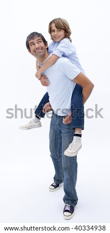 Dad giving son piggy back ride against white background - stock photo