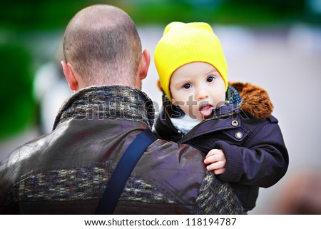 Dad keeps the boy in her arms - stock photo