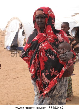 DADAAB,SOMALIA-AUGUST 15: An unidentified mother and child live in the Dadaab refugee camp where thousands of Somalis wait for help because of hunger on August 15, 2011, in Dadaab, Somalia. - stock photo