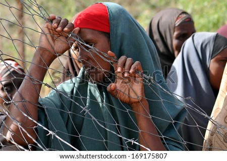 DADAAB, SOMALIA - AUGUST 7: Unidentified womans live in the Dadaab refugee camp hundreds of thousands of Somalis wait for help because of hunger on August 7, 2011 in Dadaab, Somalia. - stock photo