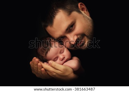 Daddy hugs his newborn baby. Father 's love.  Close-up portrait on a black background - stock photo