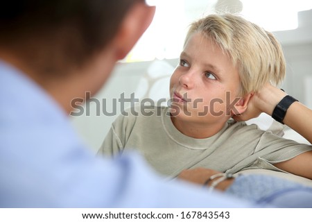 Daddy talking to his son about serious things - stock photo